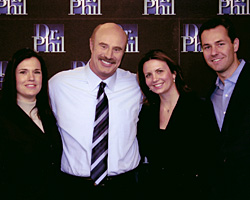 Founders of the HER Foundation thank Dr. Phil